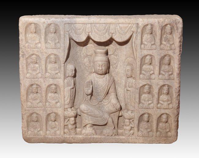 A RARE AND LARGE STONE BUDDHA