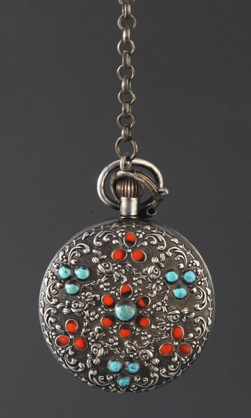 A REAR BRONZE POCKET WATCH WITH CORAL AND TURQUOISE