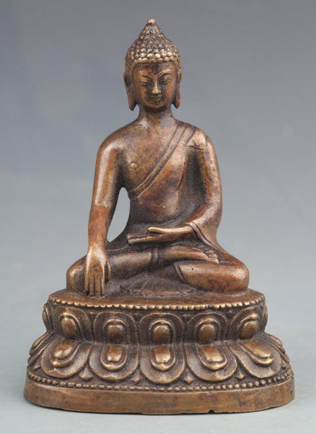 A FINELY CARVED AKSHOBHYA BUDDHA SHAPE BRONZE