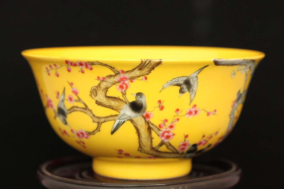 A YELLOW GROUND FAMILLE -ROSE BIRDS AND FLOWER  BOWL