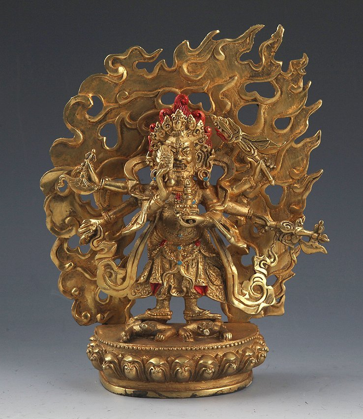 A GOLD COLOR FINELY CARVED BRONZE TIBETAN BUDDHA