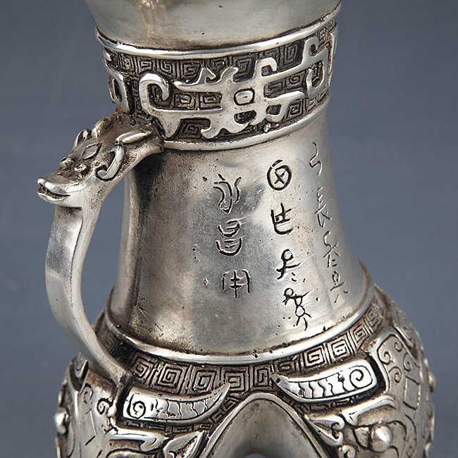 A FINELY CARVED SILVER PLATED WIN BOTTLE - 4