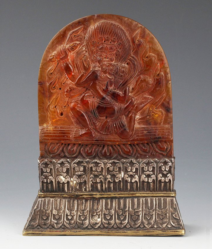A FINELY CARVED AMBER IN FORM OF TIBETAN BUDDHA