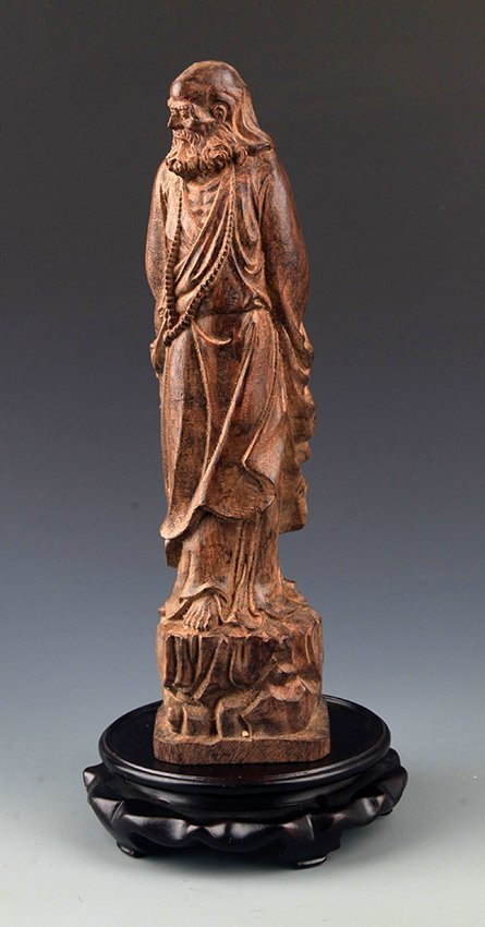 A FINELY CARVED AGAR WOOD BODHIDHARMA ROHAN
