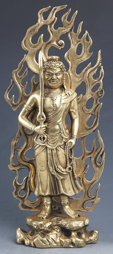 A LARGE FINLY CARVED BRONZE TIBETAN BUDDHA