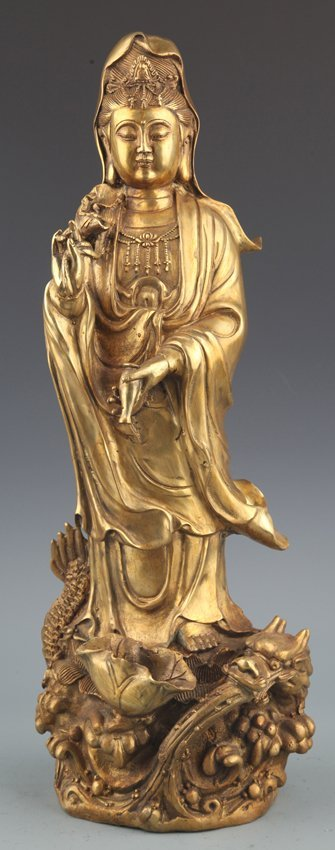 A FINELY CARVED GILT-BRONZE GUAN YIN MODEL