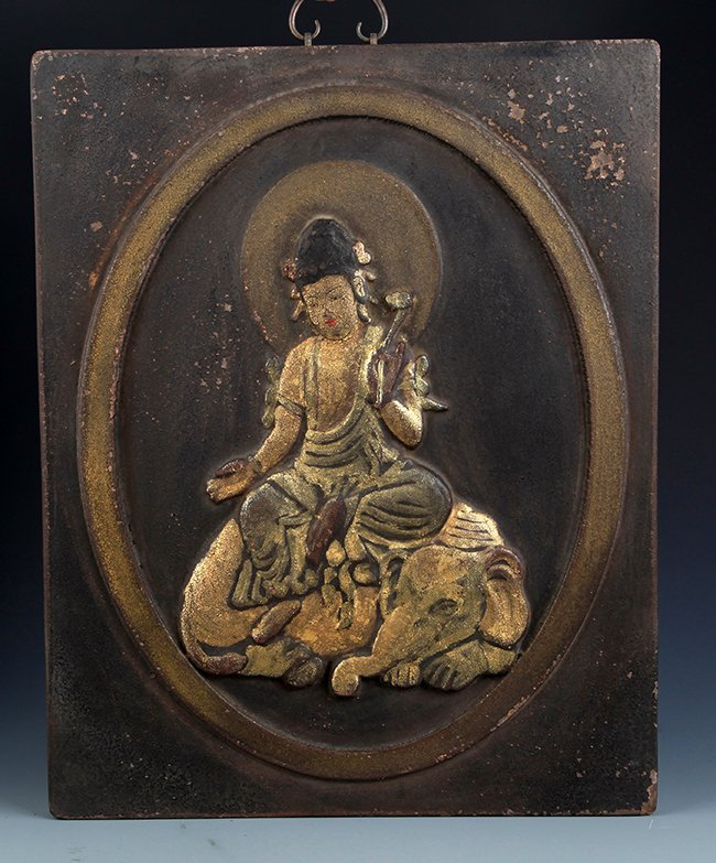 A FINELY CARVED GILT-LACQUERED GUAN YIN PANEL