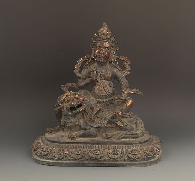 AN OLD GILT BRONZE BUDDHA