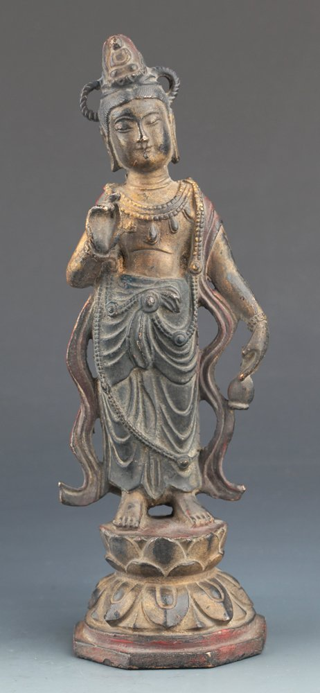 A FINELY CARVED COLORED BRONZE GUAN YIN MODEL