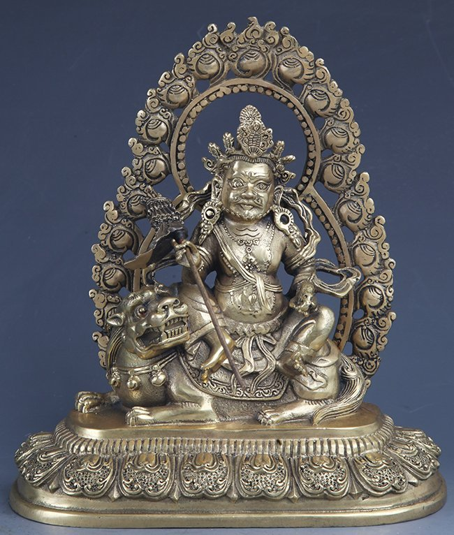 A FINELY CARVED BRONZE BUDDHA
