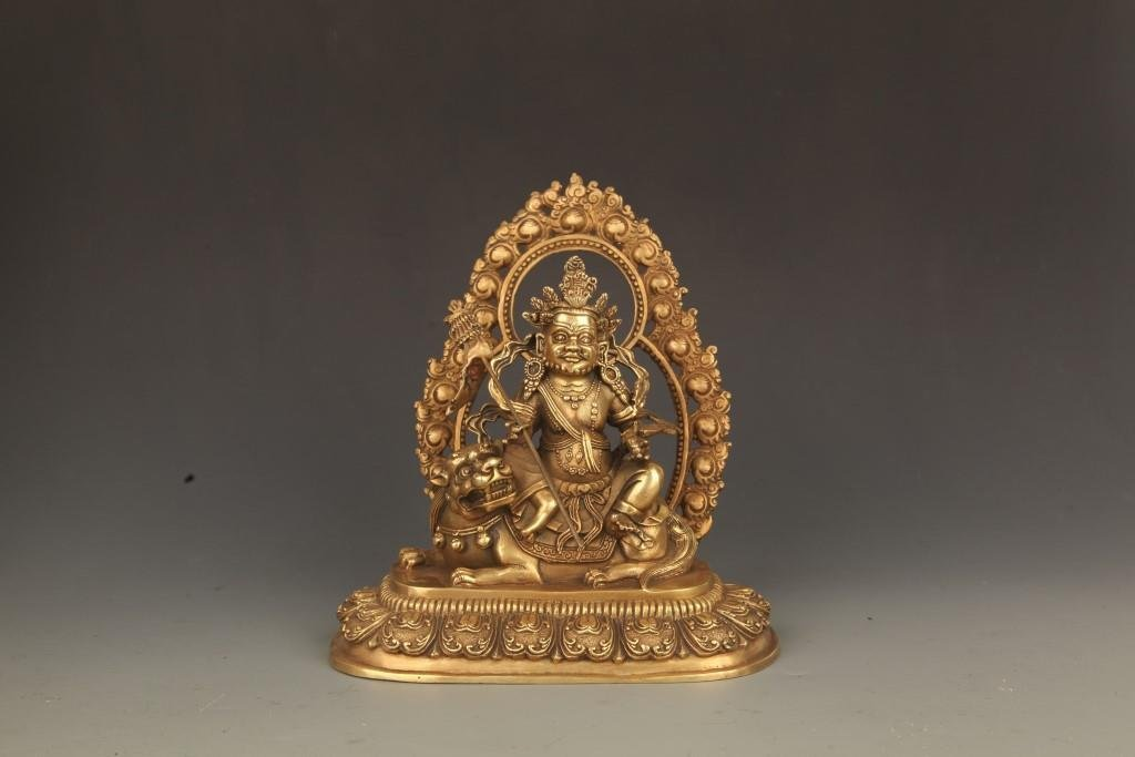 A FINELY CARVED TIBETAN GOD OF WEALTH BUDDHA