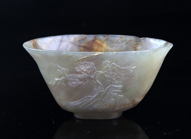 A FINELY CARVED PALE CELADON JADE CUP