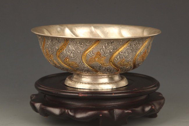 A FINELY CARVED SILVER PLATED BRONZE BOWL