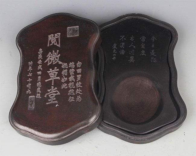 A FINELY CARVED STONE INK WITH WOODEN BOX