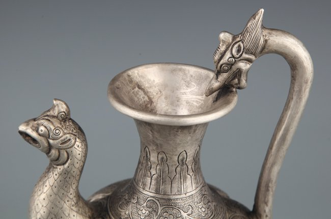 A FINELY CARVED SILVER PLATED WATER POT - 2