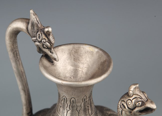 A FINELY CARVED SILVER PLATED WATER POT - 6