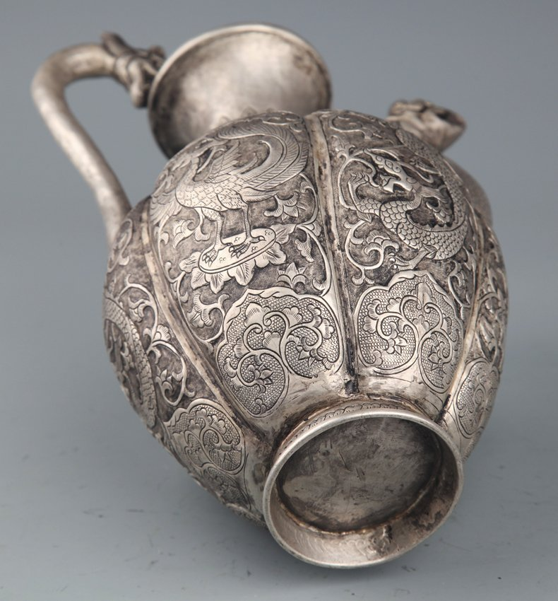 A FINELY CARVED SILVER PLATED WATER POT - 7