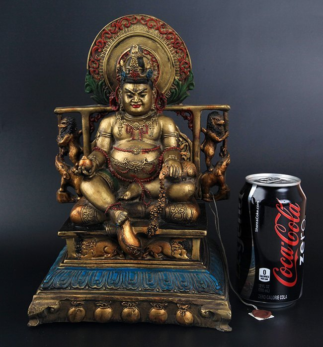 A FINELY CARVED BRONZE SETTING BUDDHA