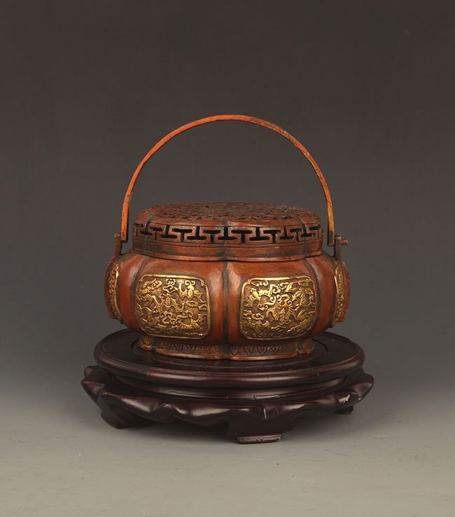 A FINELY CARVED BRONZE ROUND AROMATHERAPY