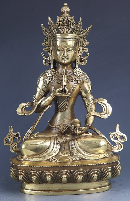 A FINELY CARVED GILT-BRONZE BUDDHA