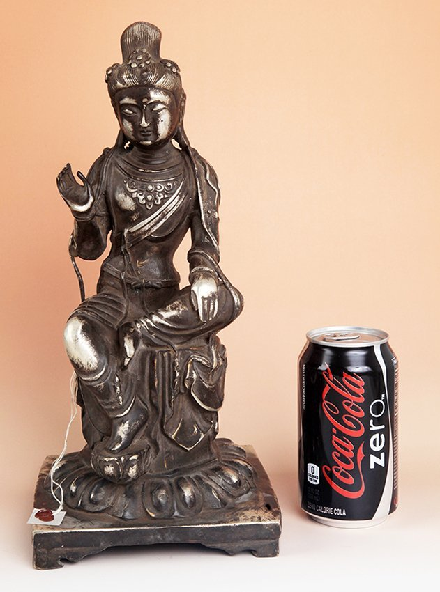 A TALL AND FINELY CARVED BUDDHA FIGURE