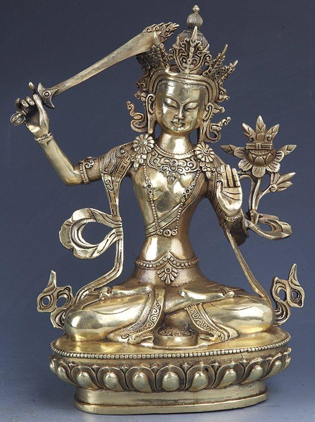 A DETAILED CARVED GILT-BRONZE BUDDHA