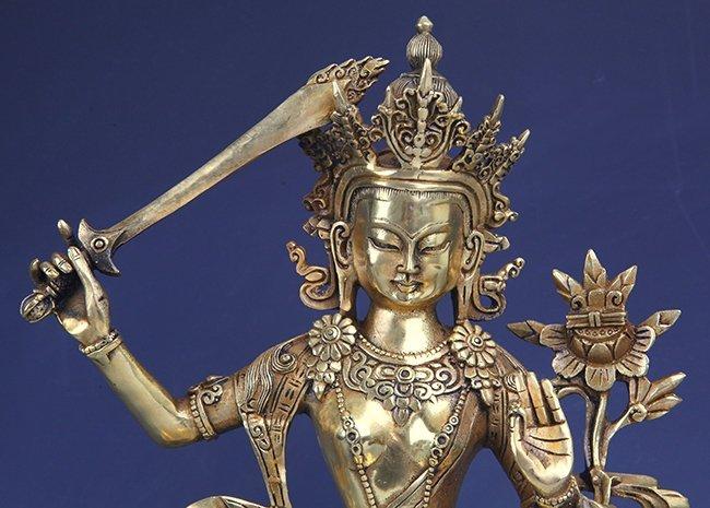 A DETAILED CARVED GILT-BRONZE BUDDHA - 2