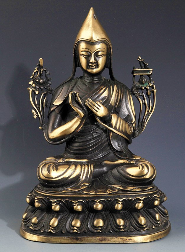 A FINELY CARVED BRONZE BUDDHA FIGURE