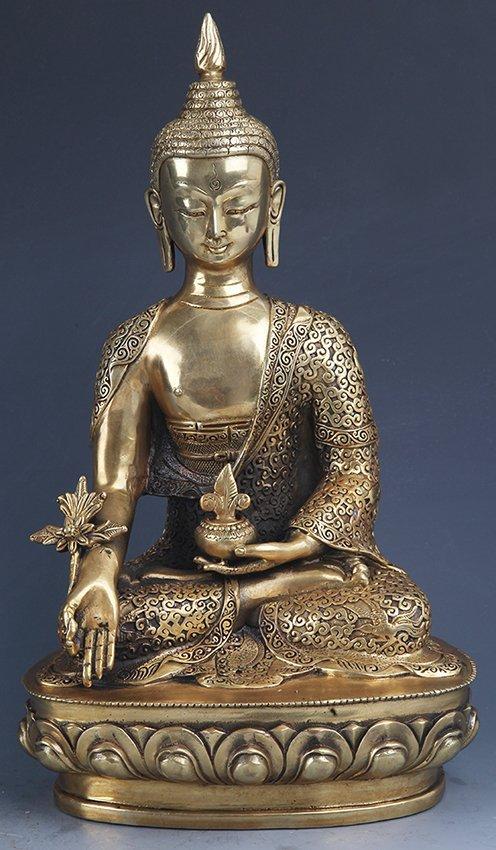 A VERY DETAILED CARVED GILT BRONZE BHAISAJYAGURU BUDDHA