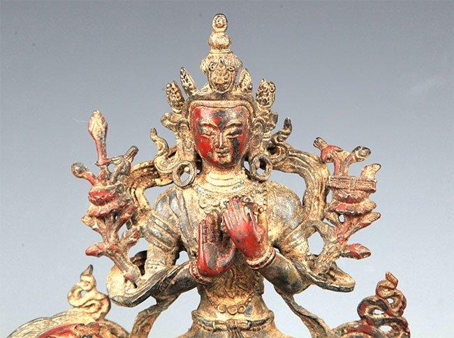 A BRONZE BUDDHA AND LION FIGURE - 2