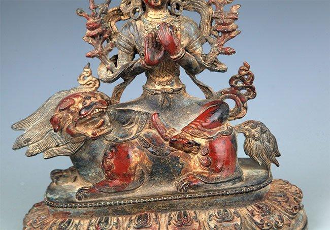 A BRONZE BUDDHA AND LION FIGURE - 3