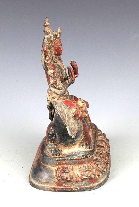 A BRONZE BUDDHA AND LION FIGURE - 5