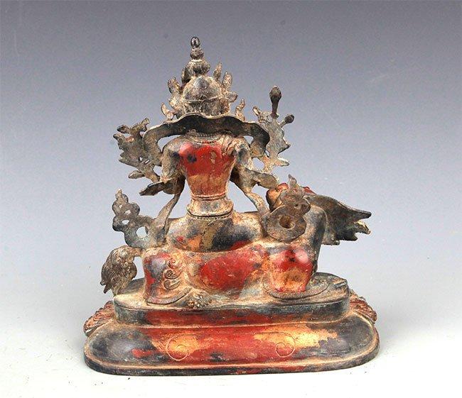 A BRONZE BUDDHA AND LION FIGURE - 6