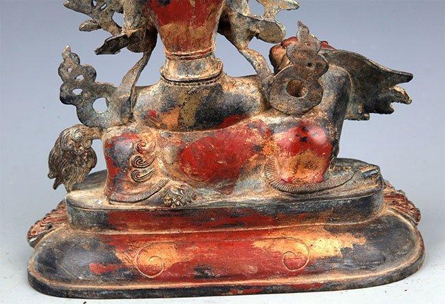 A BRONZE BUDDHA AND LION FIGURE - 8