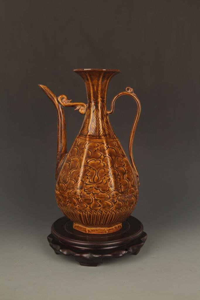 A BROWN COLOR GLAZED FLOWER PORCELAIN WATER JAR