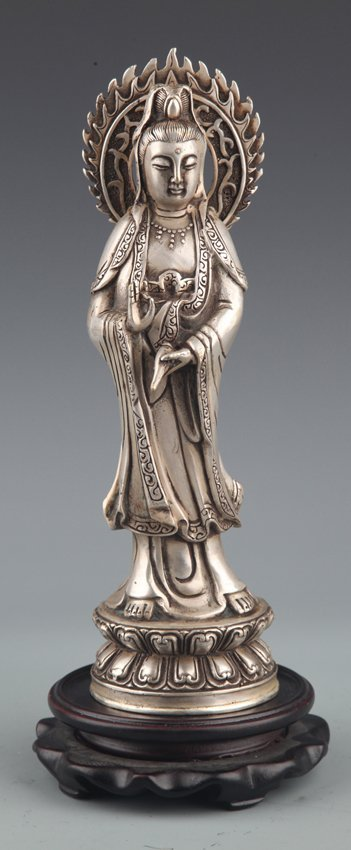 A LARGE FINELY CARVED SILVER PLATED GUAN YIN MODEL