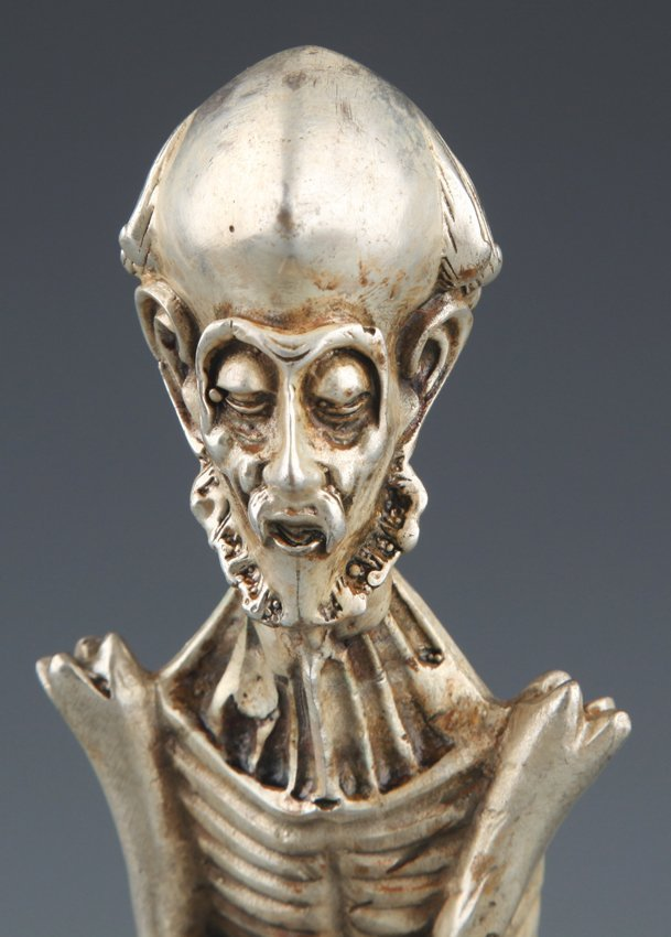 A LARGE SILVER PLATED SKULL SHAPED DECORATION - 2