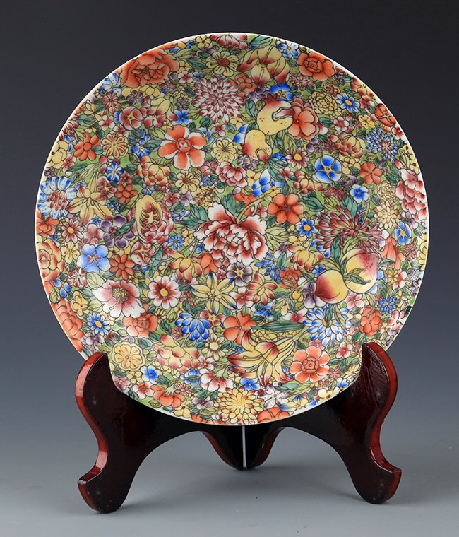 A YELLOW GROUND FAMILLE ROSE PORCELAIN PLATE