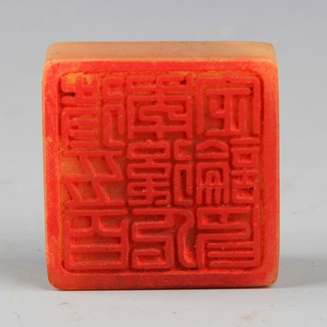 A FINELY CARVED SOAPSTONE SEAL