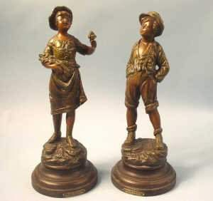 Pair boy and girl spelter figures. The y