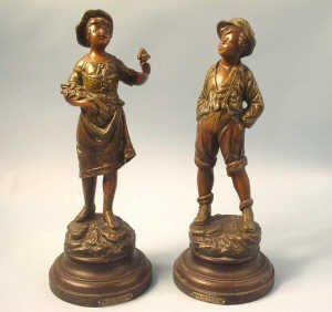 365: Pair boy and girl spelter figures. The y