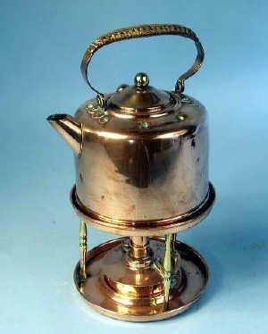 368: Copper and brass wicker handled spirit k