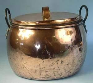 Oval lidded copper log bin with iron car