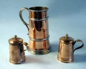 Copper and pewter jug stamped below N G