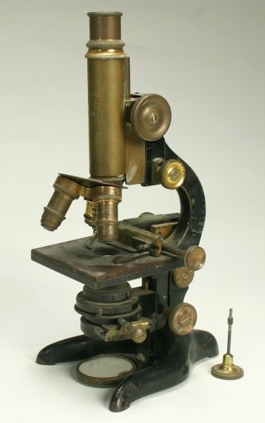 1: A lacquered and japanned brass monocular microscope,