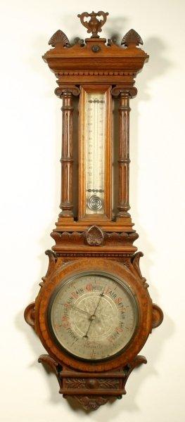 14: A Victorian carved oak aneroid wheel barometer, cir