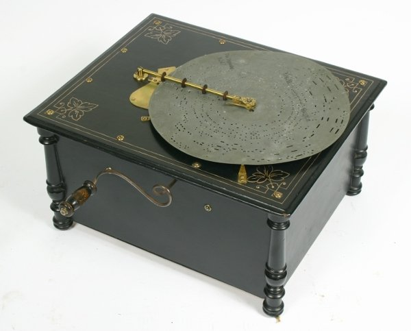 17: An Atlas-Organette, late 19th century, with 12 inch