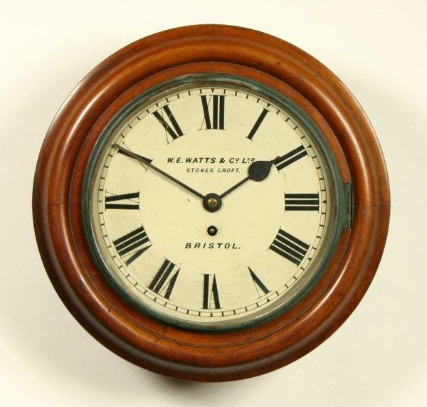 19: A mahogany dial timepiece, circa 1900, the four pil