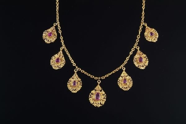 1009: A late Victorian ruby necklace, circa 1890, the s