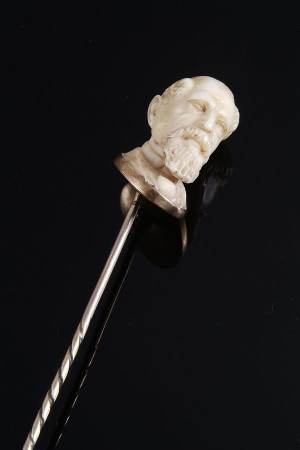 1010: An carved ivory stick pin, the ivory finely carve